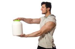 El hombre muscular con la proteína sacude en blanco Foto de archivo libre de regalías