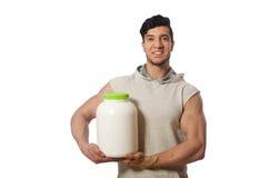 El hombre muscular con la proteína sacude en blanco Fotos de archivo