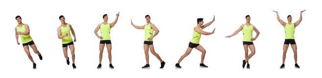 El hombre muscular joven que hace ejercicios fotografía de archivo