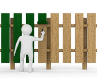 El hombre pinta la cerca en el fondo blanco Foto de archivo libre de regalías