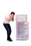 El hombre que busca la comida en refrigerador vacío imagen de archivo
