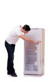 El hombre que busca la comida en refrigerador vacío foto de archivo
