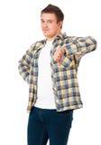 El hombre que hace el pulgar abajo firma Imagen de archivo libre de regalías
