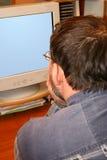 El hombre que se sienta en un vector en un lugar de trabajo. Fotos de archivo libres de regalías