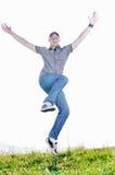 El hombre salta al aire libre Imágenes de archivo libres de regalías
