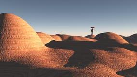 El hombre se coloca en desierto rocoso