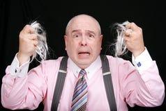 El hombre sorprendido sacó su pelo Imagen de archivo