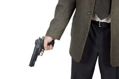 El hombre sostiene una pistola en su mano Fotos de archivo