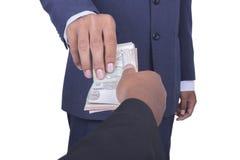 El hombre toma suavemente un dinero del soborno Imagen de archivo libre de regalías
