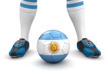 El hombre y el balón de fútbol con la Argentina señalan por medio de una bandera (la trayectoria de recortes incluida) Imágenes de archivo libres de regalías