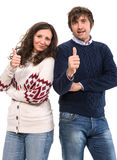 El hombre y la mujer sonrientes que muestran los pulgares suben la muestra Imágenes de archivo libres de regalías