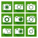 El icono de la cámara fijó en fondo verde con la sombra larga Fotografía de archivo