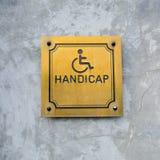 El icono y la fraseología discapacitados de la desventaja perjudican la muestra hecha del oro Imagen de archivo