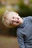 El inclinarse del muchacho Imagen de archivo libre de regalías