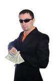 El individuo con los dólares en un juego Fotos de archivo libres de regalías