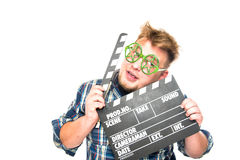 El individuo con los vidrios muestra una emoción divertida Imagen de archivo libre de regalías