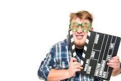 El individuo con los vidrios muestra una emoción divertida Fotos de archivo