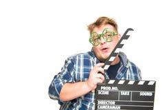 El individuo con los vidrios muestra una emoción divertida Fotografía de archivo