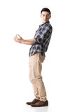 El individuo joven asiático lleva o toma algo Fotografía de archivo