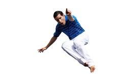 El individuo joven en un salto Imagen de archivo libre de regalías