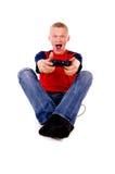 El individuo que juega emocionado a los videojuegos Imagen de archivo