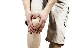 El individuo que sostiene la rodilla Fotografía de archivo