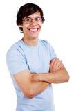 El individuo sonriente en vidrios con cruzado entrega blanco Foto de archivo libre de regalías