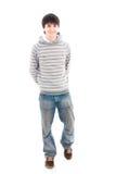 El individuo sonriente joven aislado en un blanco Imagen de archivo