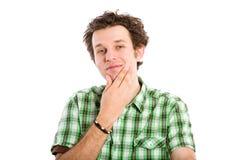 El intentar masculino joven tomar una decisión Imagenes de archivo