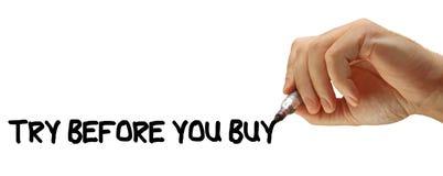 El intento del mensaje de la escritura de la mano antes de usted compra Foto de archivo libre de regalías