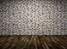 El interior de un cuarto con la pared de ladrillo y el piso de madera 3d rinden Fotos de archivo libres de regalías