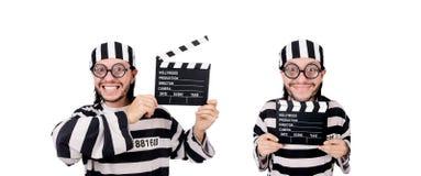 El interno divertido de la prisión con el tablero de la película aislado en blanco foto de archivo libre de regalías