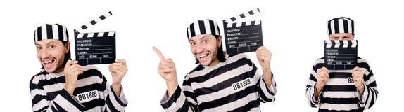El interno divertido de la prisión con el tablero de la película aislado en blanco foto de archivo