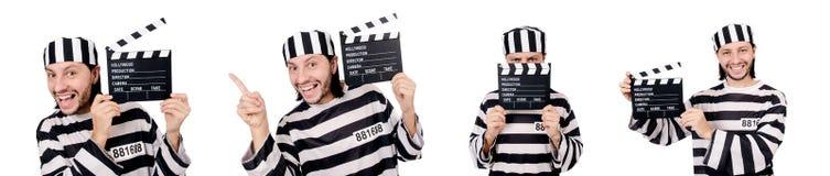 El interno divertido de la prisión con el tablero de la película aislado en blanco fotos de archivo