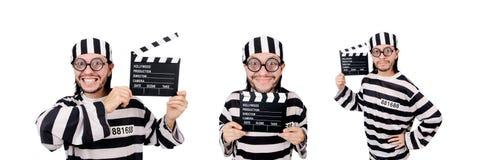 El interno divertido de la prisión con el tablero de la película aislado en blanco imagen de archivo