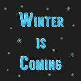El invierno de la inscripción está viniendo con los copos de nieve Foto de archivo