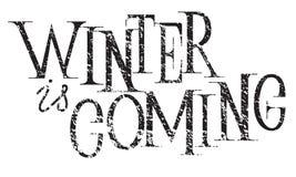 El invierno es inscripción de las letras de la mano que viene a la tarjeta de felicitación de las vacaciones de invierno foto de archivo libre de regalías