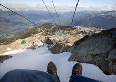 El ir abajo de la montaña de la marmota en la telesilla Foto de archivo libre de regalías