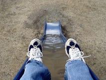 El ir abajo de una diapositiva Foto de archivo
