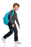 El ir del muchacho aislado en blanco Imagen de archivo