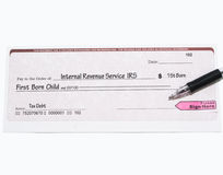 El IRS controla para saber si hay primer niño nato Foto de archivo libre de regalías