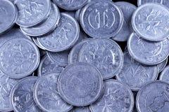 El japonés un yen acuña en un fondo negro Imagen de archivo libre de regalías