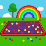 El jardín embroma con el fondo colorido del cielo de la bola y del arco iris Imagenes de archivo