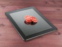 El juego salta en la PC de la tableta, juego de Tejas en línea Fotos de archivo libres de regalías