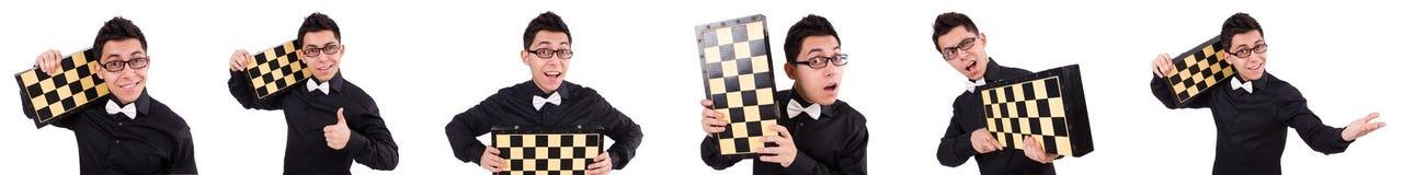 El jugador de ajedrez divertido aislado en blanco Imagenes de archivo