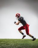 El jugador de fútbol americano en la acción Fotos de archivo