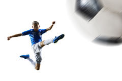 El jugador de fútbol del fútbol profesional en la acción aisló el fondo blanco Foto de archivo libre de regalías