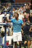 El jugador de tenis profesional Gael Monfis de Francia celebra la victoria después de que su partido 2016 del cuarto de final del fotografía de archivo