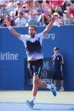 El jugador de tenis profesional Marin Cilic celebra la victoria después de que el partido 2014 del cuarto de final del US Open Fotografía de archivo libre de regalías
