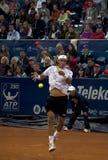 El jugador López ejecuta y vuelve una bola Fotografía de archivo